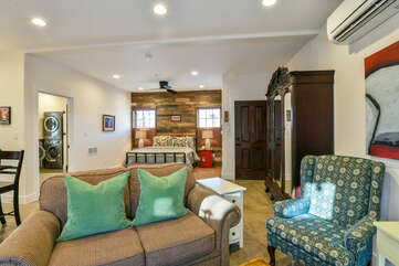 Large Bed, Nightstands, Table Lamps, Ceiling Fan, Wardrobe Armoire, and Sofas.