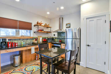 Dining Set in the Kitchen with Refrigerator and the Front Door.
