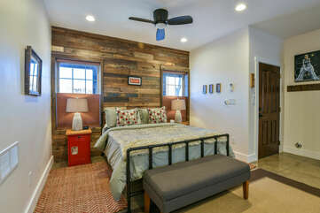 Large Bed, Nightstands,  Bench, and Ceiling Fan in Our Moab Home Rental.