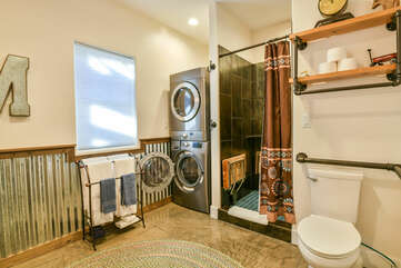 Bathroom with Laundry Set, Shower, and Toilet.