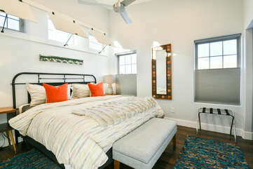 Large Bed, Nightstands, Table Lamps, Bed Bench, and Mirror.