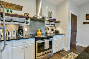 Stove, Range Hood, Refrigerator, Coffee Maker, and Toaster.