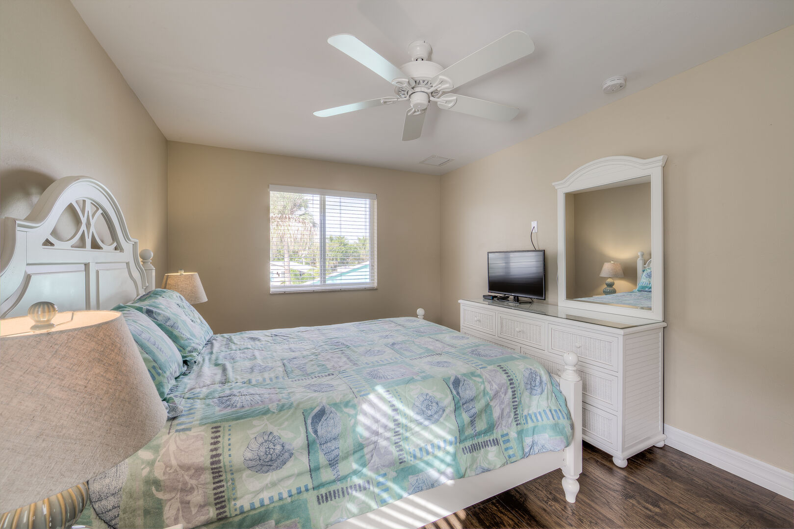 Bedroom with dresser and small TV