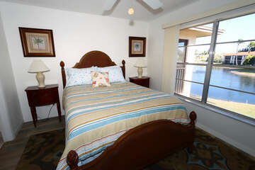 Master bedroom with Queen bed with views of the pond and fountian