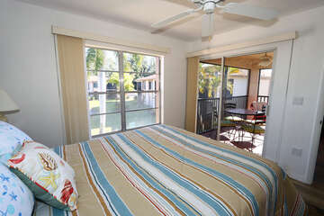 Master bedroom with Queen bed with views of the pond and fountian, with lanai access