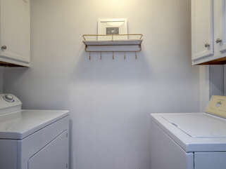 The laundry has a full-size washer and dryer