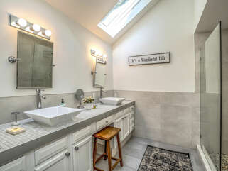 The master bath has been renovated. Skylights let the light stream in and the large vanity has 2 sinks.