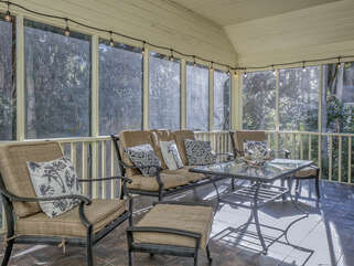 A large screen porch runs along the back of the house.