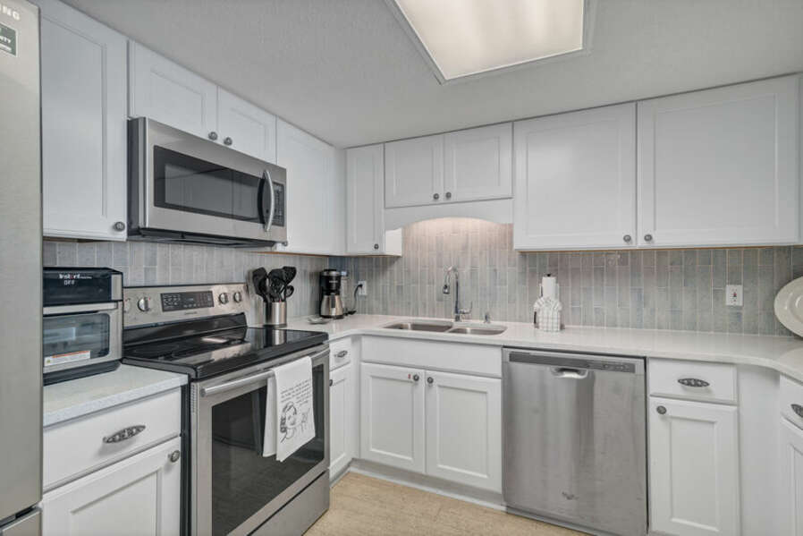 Beautifully Upgraded Fully Equipped Kitchen with Stainless Steel Appliances