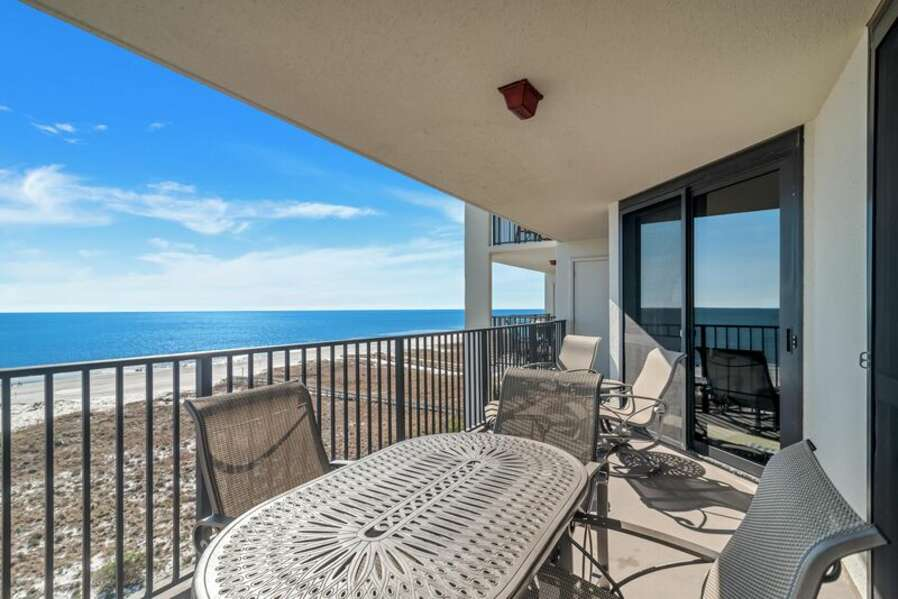 Private Sun-drenched Balcony with Plenty of Seating for Outdoor Dining and Relaxing