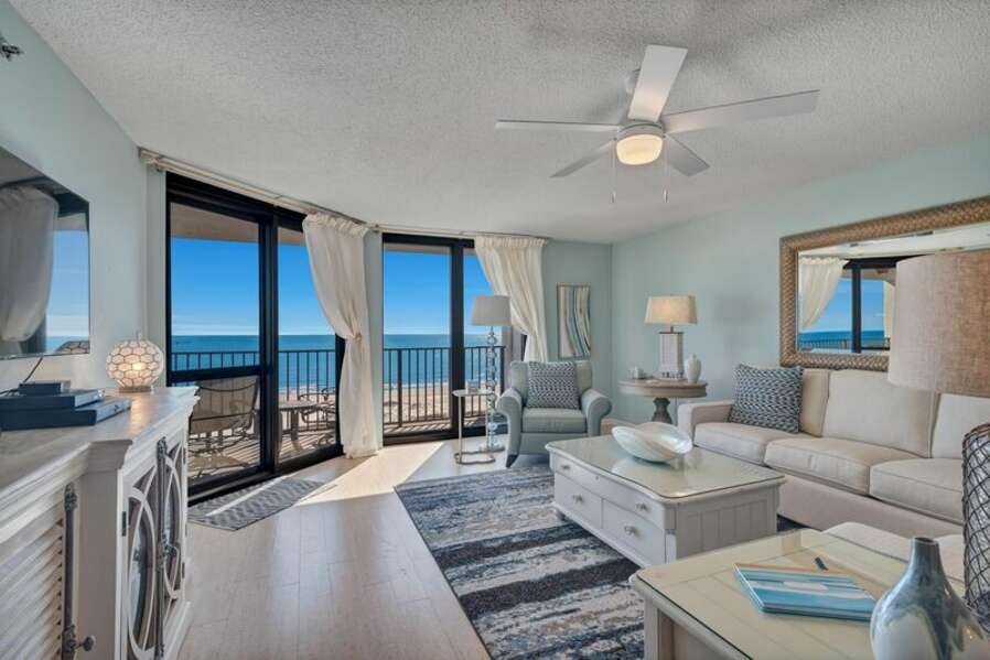 Beautiful Living Room with Plenty of Comfortable Seating, Sleeper Sofa, Flat Screen TV and Floor to Ceiling Views of the Gulf of Mexico