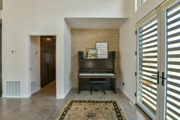 Double Glass Door, a Piano, Lamp, and Speakers.