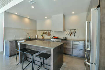 Kitchen with Island, Stools, and Refrigerator.