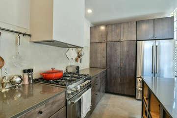 Stove, Kitchen Island, Pantry Cabinets, and Refrigerator.