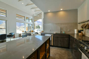 Kitchen Island, Dining Table, Chairs, Sofas, and Windows.
