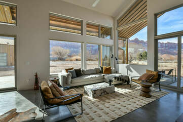 Sectional Sofa, Arm Chairs, Coffee Table, Sliding Doors, and Windows.