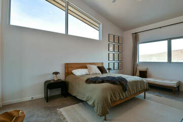 Large Bed, Nightstands, Lamps, Windows, and Bench.
