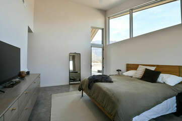 Large Bed, Drawer Dresser, Mirror, and Window.