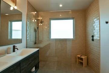 Double Vanity Sink, Shower with Glass Doors, and Window.