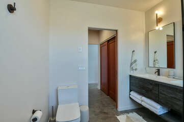 Double Vanity Sink, Mirrors, Wall Lamps, Closet Doors, and Toilet.
