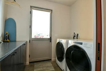 Laundry Room with Washer, Dryer and Cabinets.