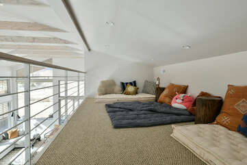 The Loft with Twin Mattresses, Pillows, and Nightstands.
