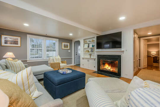 Living room with view to hallway where the 1/2 bath ,  Master bedroom and office are located- 75 Pinewood Rd Hyannis Cape Cod- New England Vacation Rentals