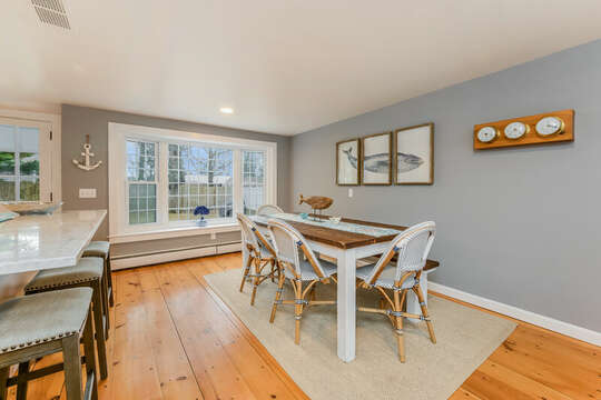 Plenty of room for the whole family at this beautiful dining table , bench seating is against the wall.-75 Pinewood Rd Hyannis Cape Cod- New England Vacation Rentals