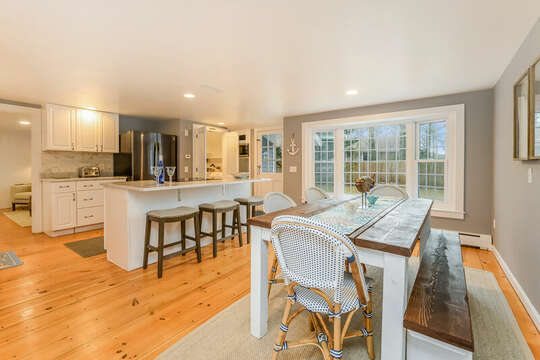 Chefs delight in this modern open concept kitchen / dining area with additional seating for 3 at the center island-75 Pinewood Rd Hyannis Cape Cod- New England Vacation Rentals