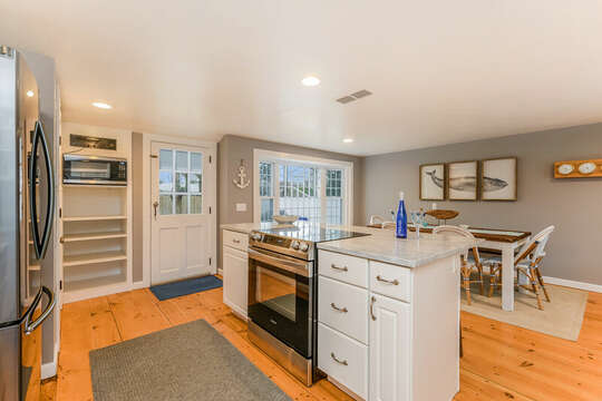 Modern open concept kitchen with entry to back yard-75 Pinewood Rd Hyannis Cape Cod- New England Vacation Rentals