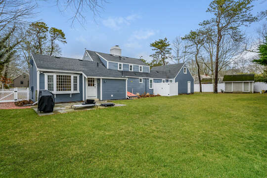 Fully fenced in back yard is perfect for out door entertaining, lawn games or playing fetch with your pup-75 Pinewood Rd Hyannis Cape Cod- New England Vacation Rentals