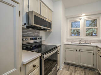 The renovated kitchen is fully stocked. Stainless steel appliances and granite countertops.