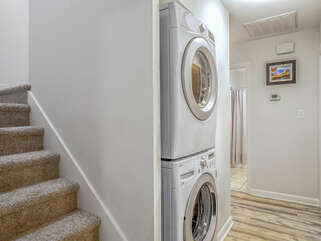 The carpeted stairs take you up to the loft. The new stacked washer and dryer.