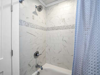 The newly tiled shower/tub combo.