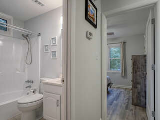 The updated hall bath sits just off the guest bedroom
