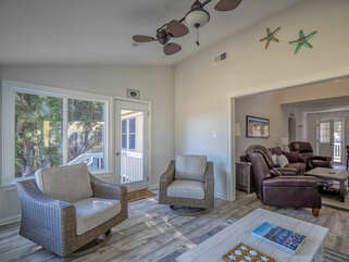 This room is full of light. Surrounded by windows, bringing the beautiful nature of Seabrook island to your back door.