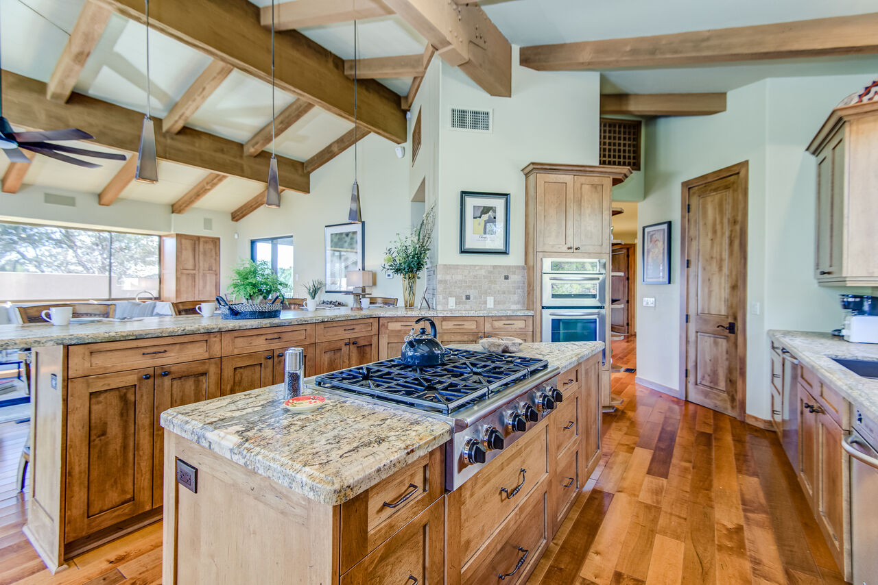 Fully Equipped Chef's Kitchen with Lavish Granite Counters and Custom Cabinetry, and Maple Hardwood Flooring