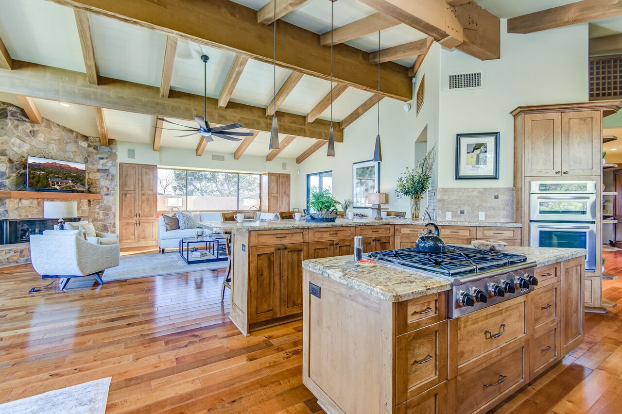 Warm and Open Great Room with Custom Woodwork Throughout