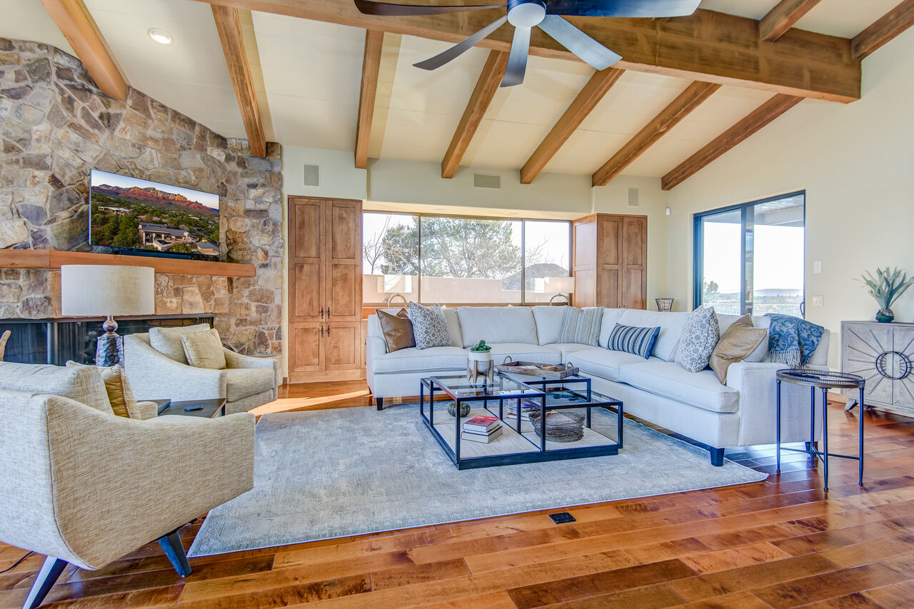 Living Room with All New Furnishings, Gorgeous Maple Hardwood Flooring and a Vaulted Wood-Beam Ceiling