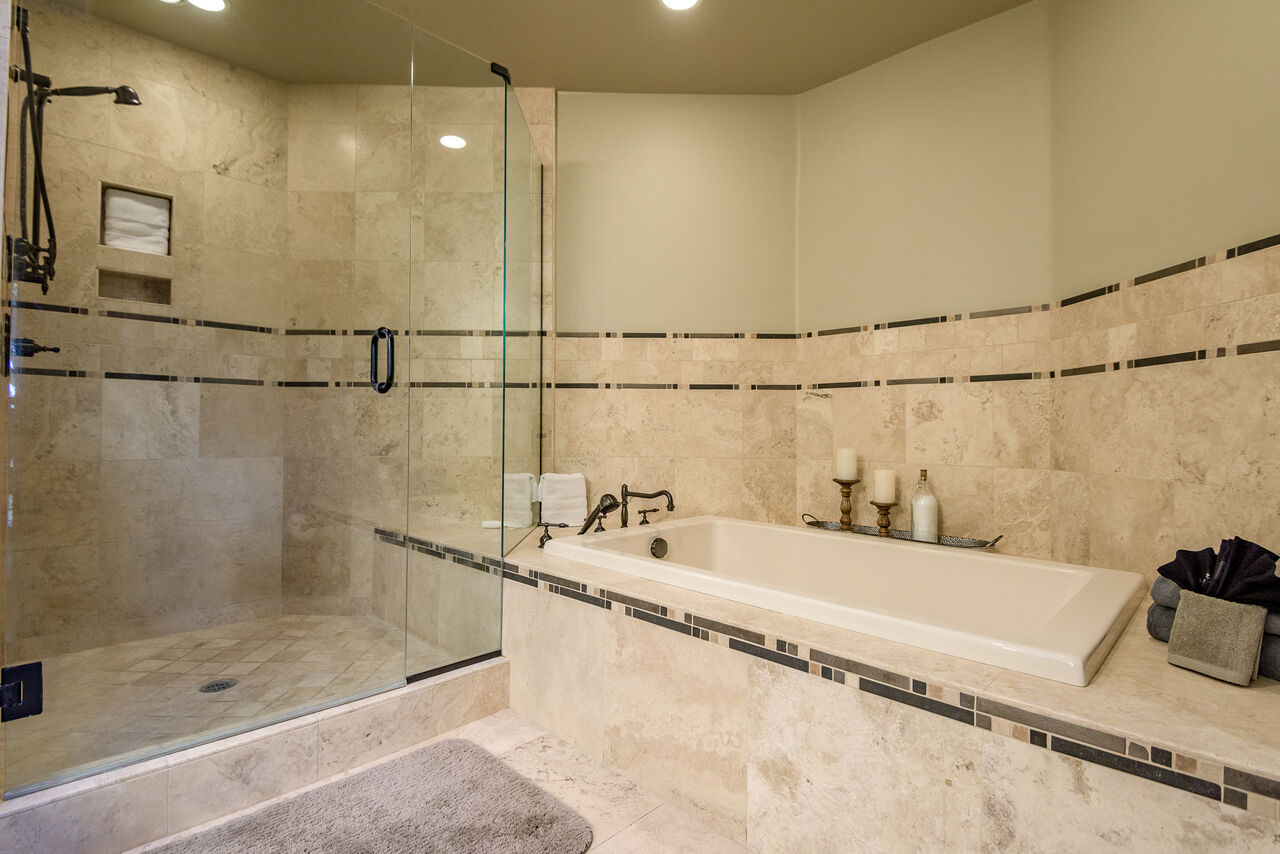 Grand Master Bath with a Jetted Tub and Tile/Glass Shower
