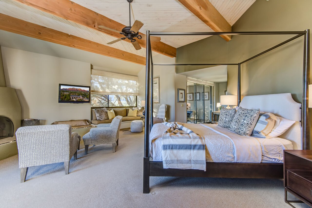 Grand Master Bedroom with a Queen Bed