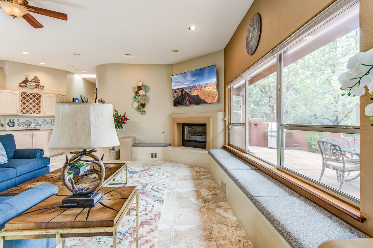 Large Window with Bench Seating, a Cozy Gas Fireplace and 75