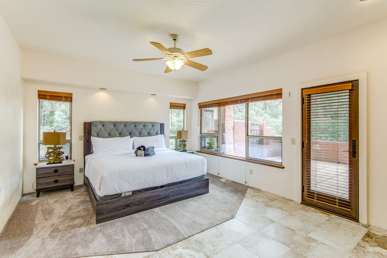 Grand Master Bedroom with a King Bed and Patio Access