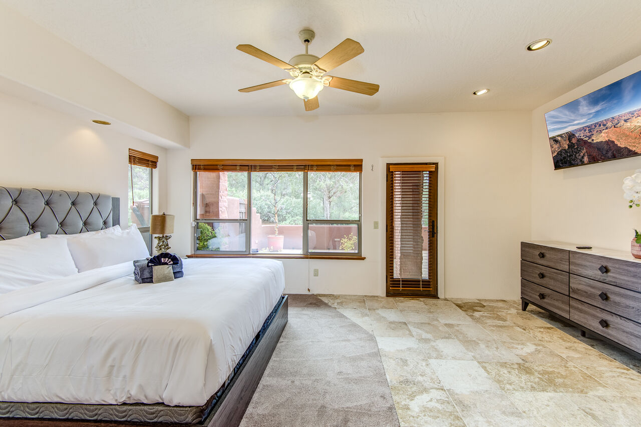 Grand Master Bedroom with a King Bed and a Smart TV