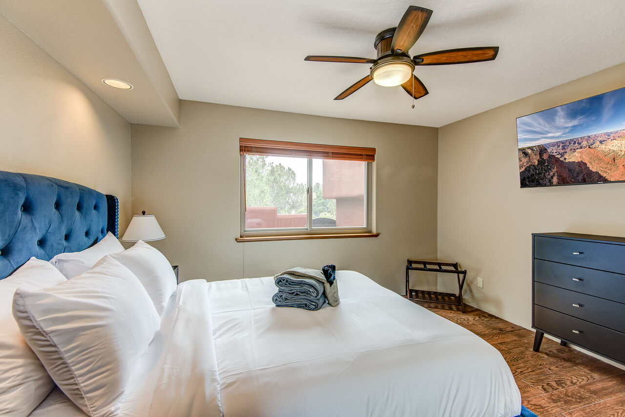 Bedroom 3 with a Queen Bed and Smart TV with Access to a Full Shared Bath