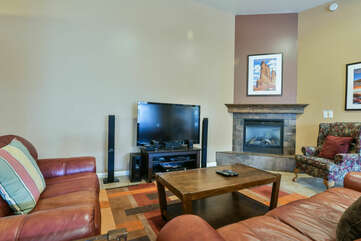 Coffee Table, Sofas, TV, and Fireplace.