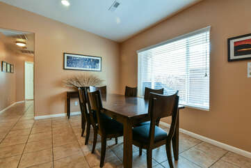 Dining Table, Chairs, Buffet Table, and Window.