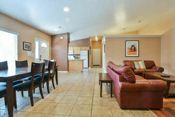 Console Table, Sofas, Dining Set, and the Kitchen with Refrigerator.