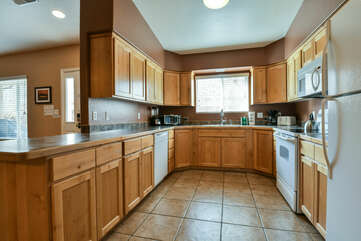 Kitchen with Dishwasher, Microwave, and Refrigerator.