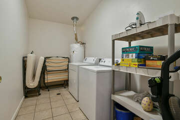 Laundry Room with Washer and Dryer, and Two Rollaway Beds.